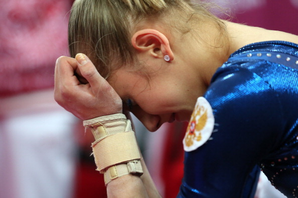 jennydeane:   Komova reacts to the sound of Katy Perry's 'Firework' at the end of the all-around.      ^this