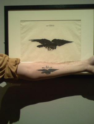 "I found my tattoo at the MFA in Boston, MA after a year after getting it. It's from a series of prints done by Edouard Manet to accompany a French edition of The Raven by Edgar Allen Poe in 1875. Included in the collection was the ""ex libris"" bookplate that my tattoo was based on (I didn't even know it was on display there!); super nerdy and exciting moment, to be sure!  Incredibly unique and beautiful. Kudos on the awesome tattoo - and thank you for the submission!"