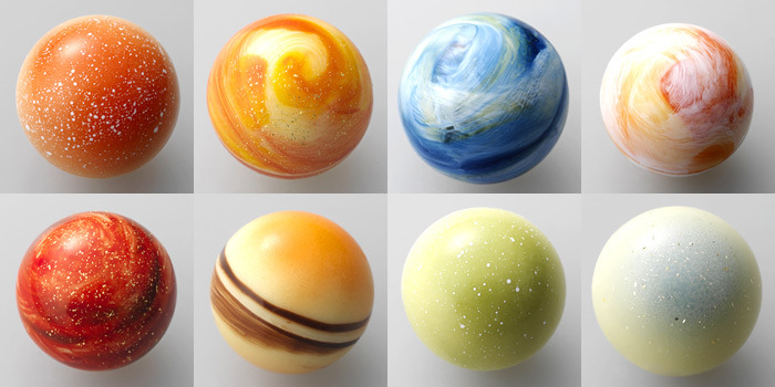 "eveningowl:  onlyjapan:  Japanese Chocolate, ""Brightness of a planet.""  ☆Mercury, Flavor: Coconut mango.  ☆ Venus, Flavor: Cream lemon.  ☆ Earth, Flavor: Cacao.  ☆ Mars, Flavor: Praline orange.  ☆ Jupiter, Flavor: Vanilla.  ☆ Saturn, Flavor: Rum raisin.  ☆ Uranus, Flavor: Sweetened black tea with milk.  ☆ Neptune, Flavor: Cappuccino  #I'm thinking Pluto tastes like loneliness and betrayal"