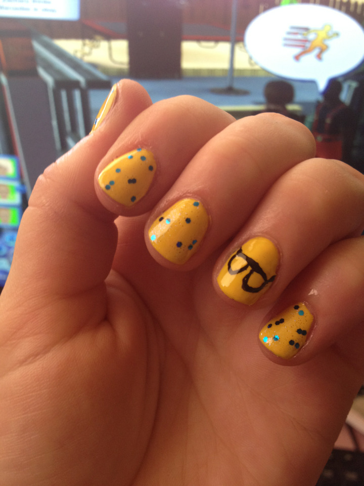 "Hipster nails. The yellow is Ruby Kisses ""Yellow Bikini"". This polish was only $1 and its amazing! Opaque and dries really fast, but I think thats because its a neon. The glitter is Orly's ""Spazmatic"". The black is just a nail art pen. I'm not too happy about the glasses, but its whatever. The backround is the sims."
