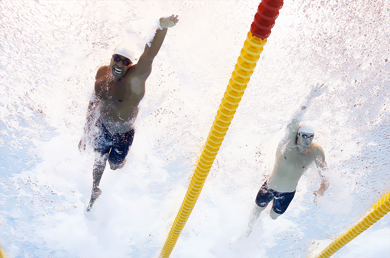 OLYMPICS DAY 6 USA's Cullen Jones and Australia's James Magnussen compete in a men's 50m freestyle heat Photo by David J. Phillip