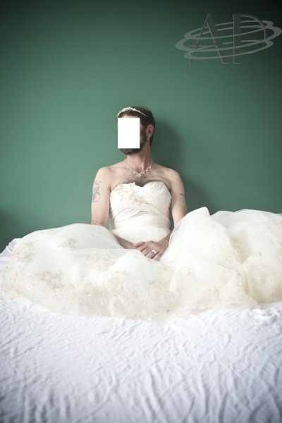 A man's dream came true when he bought a wedding dress for himself on his 50th birthday. I was honored to take his picture. He said he felt beautiful. He was. *face blocked for privacy* Comments are encouraged, as I would like to share this with him to show that love and tolerance really do exist. Comments can also be made HERE.