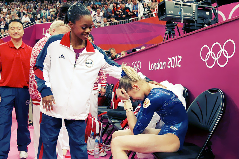 OLYMPICS DAY 6 Gabby Douglas comforts a crying second-place Russia's Viktoria Komova at the women's individual all around ——— How much more likeable can this girl get!? Such great sportsmanship!
