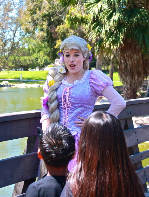 "aurorahermione:  LOL more Rapunzel I'm pretty sure this is when I was singing ""I See the Light"" at the request of the kids.  It was so cute, because they asked me to sing ""the song from when I was in the boat"".  Since I love to sing I was happy to oblige!  The kids were so cute about it!  It made me so happy to see the joy on their faces! Photo by Jane Lee"