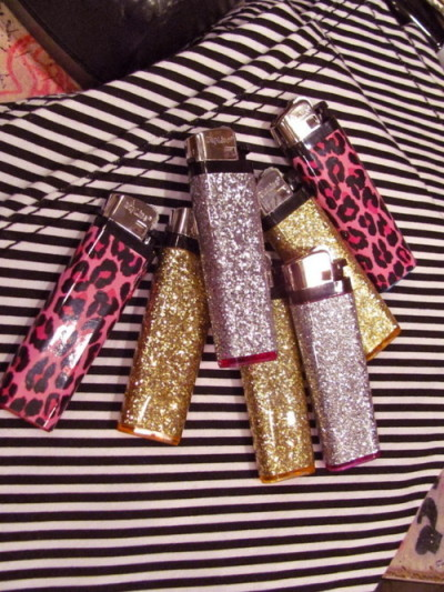 Glitter and pink leopard lighters.