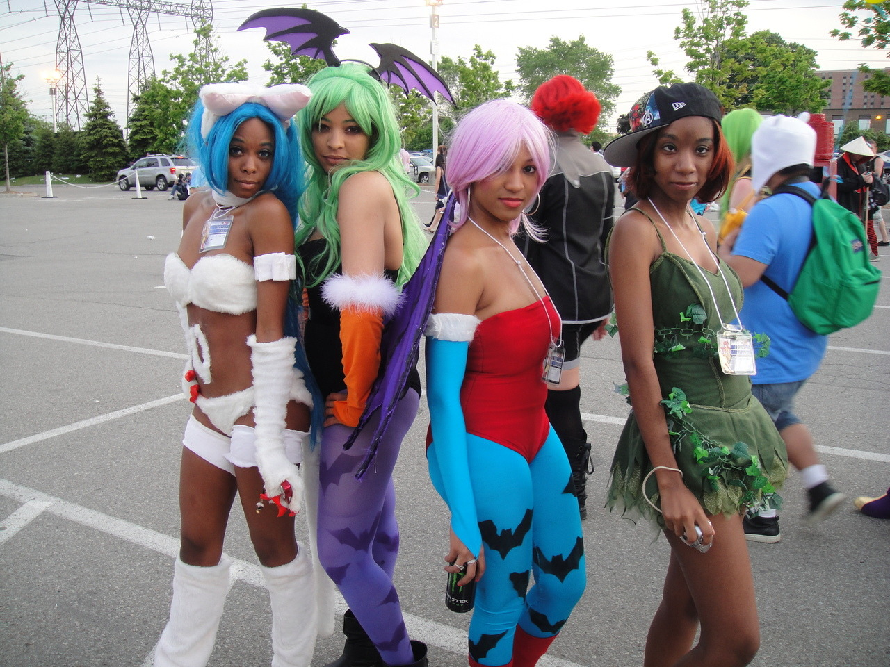 freshest-tittymilk:  awesome black cosplayers… the girl on the far right wasn't going to be in the picture, you could tell she was self concious, i didn't care… i like to see people trying ((ngl, that morrigan BODIED it doe! lilith had a cute bum, too))  Characters: Felicia, Morrigan, Lilith, Original Costume Series: Darkstalkers SUBMISSION