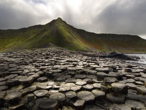 opticoverload:  The Giant's Causeway (known in Irish as Clochán an Aifir or Clochán na bhFómharach) is an area of about 40,000 interlocking basalt columns, the result of an ancient volcanic eruption. It is located in County Antrim on the northeast coast of Northern Ireland