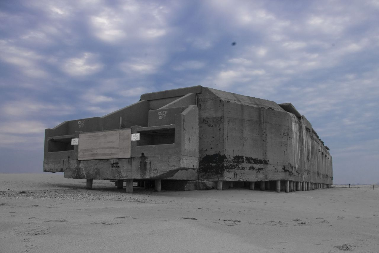 Cape May Point WWII bunker, photo by James Simard. Located just east of the Cape May Point Light House in what is now Cape May Point State Park, New Jersey, the bunker was built by the US Army Corps of Engineers during the early months of the Second World War. It contained heavy artillery and was manned by a rotating detail of naval gunnery crews, who spent hours on end scanning the horizon for enemy surface ships and submarines. (In fact, a German U-Boat commander surrendered his vessel just off the coast of Cape May at the end of World War Two) The vigilant fighting men in the Cape May Point bunker saw little combat, but if the war had taken a turn for the worse, these sailors would have been our last line of defense on the Atlantic seaboard. They may not have gotten much of the glory, but the boys manning this coastal battery were heroes in the truest sense of the word, all those years ago.