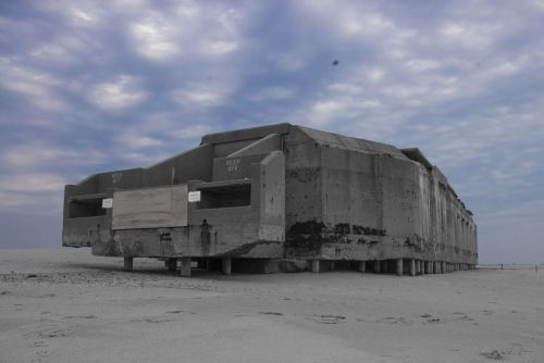 dequalized:  Cape May Point WWII bunker, photo by James Simard. Located just east of the Cape May Point Light House in what is now Cape May Point State Park, New Jersey, the bunker was built by the US Army Corps of Engineers during the early months of the Second World War. It contained heavy artillery and was manned by a rotating detail of naval gunnery crews, who spent hours on end scanning the horizon for enemy surface ships and submarines. (In fact, a German U-Boat commander surrendered his vessel just off the coast of Cape May at the end of World War Two) The vigilant fighting men in the Cape May Point bunker saw little combat, but if the war had taken a turn for the worse, these sailors would have been our last line of defense on the Atlantic seaboard. They may not have gotten much of the glory, but the boys manning this coastal battery were heroes in the truest sense of the word, all those years ago.