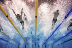 siphotos:  Michael Phelps (left) and Germany's Steffen Deibler (right) compete during the Men's 100 Meter Butterfly semifinals on Thursday. The two will race for a medal this afternoon. Phelps currently holds the all-time Olympic record for overall (20) and gold medals (16). (Heinz Kluetmeier/SI) ANDERSON: Phelps-Lochte is the greatest rivalry in swimming historyGALLERY: Best SI Shots from Day 6 of the Olympics | U.S. Medalists