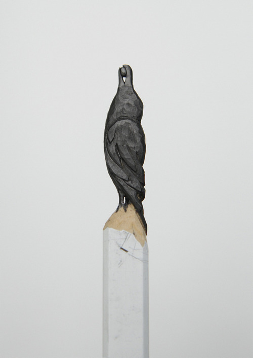 gazzelle:  Diem Chau A raven carved out of a graphite pencil.