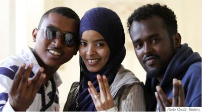 "Referred to by some as the hip-hop renegades, Somali artists ""Waayaha Cusub"" (meaning ""new era"") are taking the world by storm! The group was recently covered in a Rolling Stone Magazine article which canvassed their love for music as much as their love for Somalia! The group consists of Shiine Akhyaar, the lead singer and manager; his wife and lead vocalist Falis Abdi; and tenor singer Dikriyow Abdi. Shiine describes the harrowing tale of being forced out Mogadishu and eventually being shot several times because of his and the group's love for Music and their need to spread peace through song and dance. For those of you wondering about Somali music, it refers to the musical styles, techniques and sounds of Somalia, which are centred on traditional Somali folklore. Most Somali songs are pentatonic in the sense that they only use five pitches per octave in contrast to a heptatonic (seven note) scale. While mostly singers are highlighted through Somali music, its songs are usually the product of collaboration between lyricists (midho), songwriters (lahan), and singers ('odka or ""voice""). Read Waayaha Cusub's coverage in the Rolling Stone Magazine here and make sure to catch them play at the Somali Concert Tour for Peace on Aug 28nd in New York."