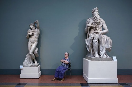 "Guardians of Russian Art Museums. by Andy Freeberg (via my modern met)  ""These women who appear to be guarding artwork in museums aren't actually employed to be protecting the history that surrounds them. In fact, these Russian women simply like to sit and guard the collections in art galleries because they enjoy being surrounded by Russia's great art….   It's interesting to imagine what each woman's personality must be like based on which artwork she chooses. ""     notice: elbows and legs"