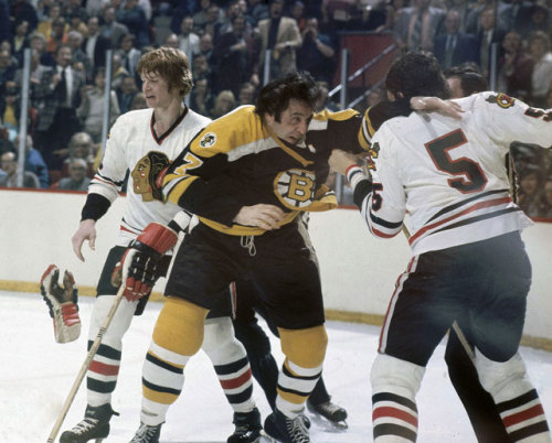 siphotos:  Phil Esposito and Phil Russell drop the gloves (with Keith Magnuson in the background) during a 1974 Bruins-Blackhawks at Chicago Stadium. (Heinz Kluetmeier/SI) GALLERY: Classic Photos of the Boston Bruins
