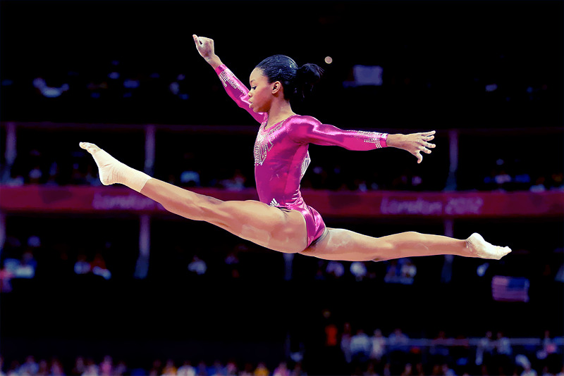 OLYMPICS DAY 6 Gabby Douglas competes on the balance beam in Gymnastics Women's Individual All-Around Photo by Streeter Lecka