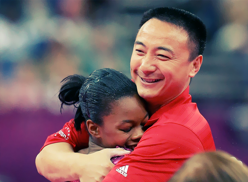 OLYMPICS DAY 6 Gabby Douglas hugs coach Liang Chow after the unven bars in Gymnastics Women's Individual All-Around Photo by Ronald Martinez