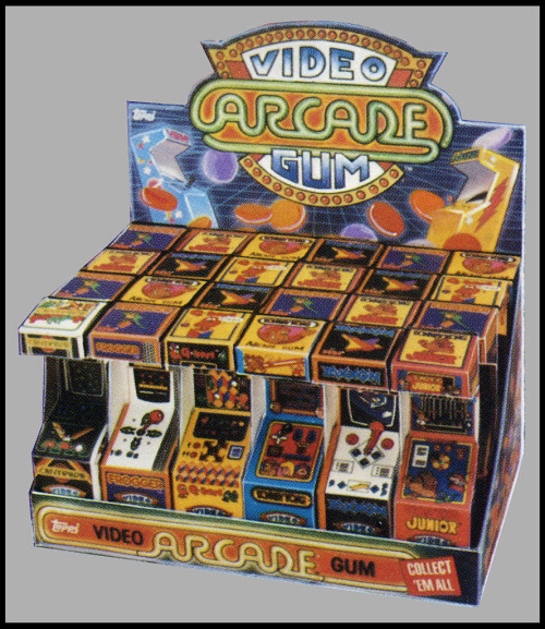 "Video Arcade Gum ""Released in the mid-1980′s, Topps Video Arcade Gum are the earliest examples of a candy container designed to look like a piece of gaming hardware."" [Collecting Candy]"