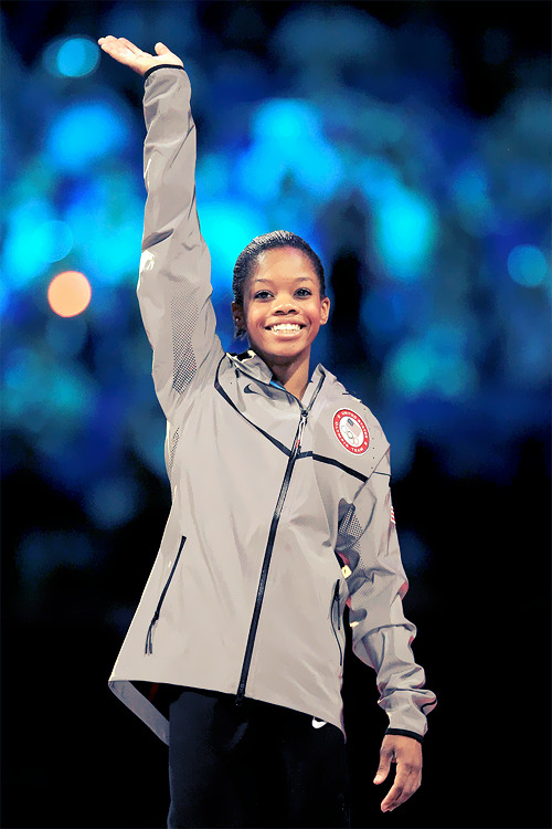 OLYMPICS DAY 6 Gabby Douglas of the United States celebrates after winning the gold medal in Gymnastics Women's Individual All-Around Photo by Ronald Martinez