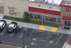 "equalitopia:  Chick-fil-A in California vandalized on ""National Same-Sex Kiss Day""From the Los Angeles Times:  ""On a day that some gay-rights activists are planning a ""National Same Sex Kiss Day,"" a Chick-fil-A in Torrance, California was vandalized overnight with hateful graffiti.""   Read the full article on Los Angeles Times(Photo credit: KTLA-TV)"
