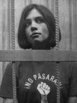 "chicadificil:  One of the singers of punk-feminist group ""Pussy Riot"", imprisoned for singing against Putin in Christ the Savior Cathedral is taken to court wearing a shirt with a fist and the words ""NO PASARÁN"" in Castilian"