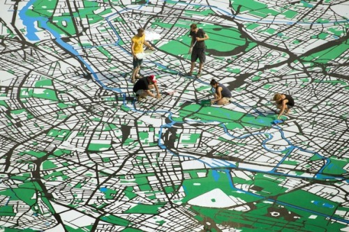 theatlantic:  Happy Birthday, Berlin! Here's a Giant Map.  Berlin is turning 775 this year. To celebrate, a team of eight artists are creating a giant city map in a central square. The 2,500-meter map will be at a scale of 1:775. When it opens on August 25, visitors can walk on top, pointing out their home and office to friends.  Read more. [Image: Reuters]