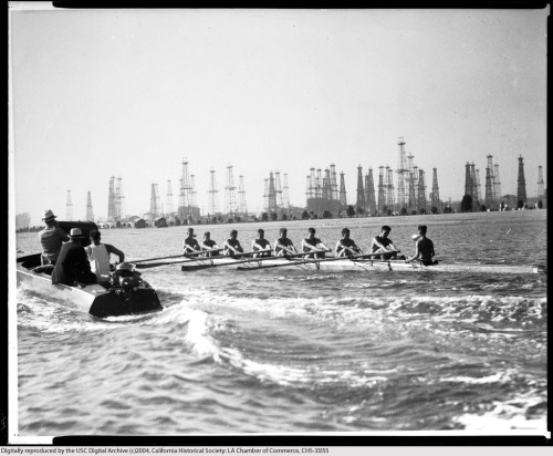 Olympic rowers during the 1932 games in Los Angeles, with Long Beach oil derricks in the background. Part of the Los Angeles Area Chamber of Commerce Collection in the USC Digital Library.