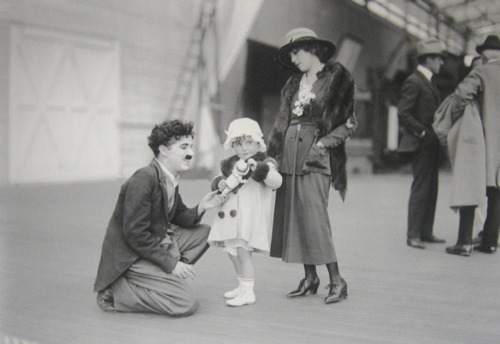 "Charlie with Mary Pickford & her niece Gwynne at the Chaplin Studios, I always liked how he would get down to the child's level to talk with them, most adults don't and it can be intimidating for children.  This is a photo from the former tumblr blog chaplininpictures, she no longer has this blog but has started a new one with great photos worth a look of Charles Chaplin the man and Charlie ""the tramp"". http://discoveringchaplin.blogspot.com/"