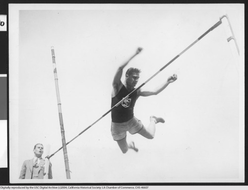 USC Trojan and gold-medal Olympian Lee Barnes, in mid pole vault, 1924. From the Los Angeles Area Chamber of Commerce Collection in the USC Digital Library.