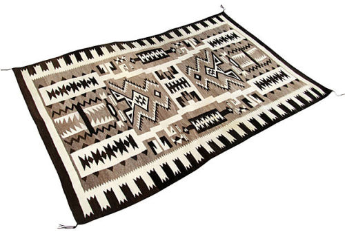 Antique Navajo rug with stunning black, white, and gray pattern that is as modern today as when it was woven 100 years ago. Freshly cleaned by the famous Robert Mann, who corrected some dye bleed and staining. There is an A side and B side, with the A side showing very little yellowing. Even so, this is the Navajo rug to own; unique and graphic. Available now on Ruby + George.