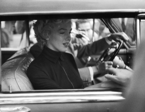 life:  Not originally published in LIFE: Marilyn Monroe at the time she filed for divorce from Joe DiMaggio, Beverly Hills, October 1954. Of the October 1954 divorce filing, meanwhile, LIFE told its readers in October 1954:  Even for Hollywood, where unhappy endings for the real love stories come with almost unseemly haste, this ending seemed abrupt. It was only last January that the press was mobbing the San Francisco city hall, waiting for Joe DiMaggio and Marilyn Monroe to emerge as newlywed man and wife. Now the press was gathered again in front of the DiMaggio home in Beverly Hills, waiting for Joe and Marilyn to come out as newly-separated man and wife.   Nobody had been surprised when they got married — they had been going with each other for two years. Nobody doubted their love — they had smiled happily through their married life. And almost nobody professed surprised when they broke up — the conflict in their two careers seemed inevitable.  See more photos here.