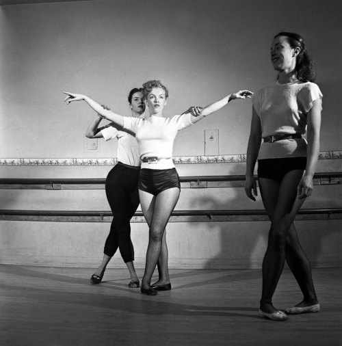 life:  Not published in LIFE. Marilyn Monroe, 22, takes dance lessons, Hollywood, 1949. While it's hardly evident in these warm and carefree photos, the next few months in Marilyn's career would be marked by struggle. Later in 1949, desperate for money, she posed naked for a pinup calendar, a gig that paid her just $50 and later came back to haunt her. (The pictures wound up in the debut issue of Playboy). But the beautiful and, as importantly, the tenacious Marilyn pushed on. She watched, practiced and learned, and as she honed her talent her opportunities grew.
