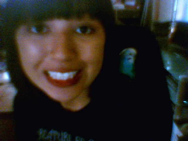 On my desktop with Bebie on my shoulder. :)