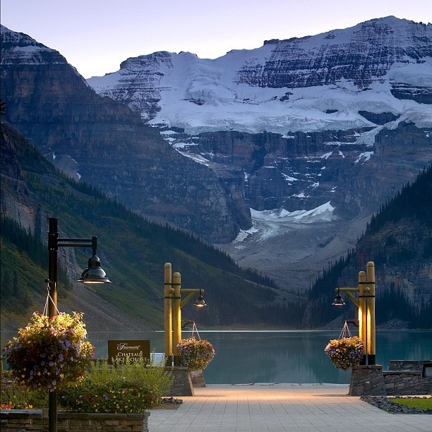 A scene from #Chateau Lake Louise, in #Banff National Park, #Canada. The #lighting of the formal gardens features #GE PulseArc Multi-Vapor metal halide lamps, providing soft pools of #light for pedestrians traveling between the waterfront and the hotel. Don't forget to post a nighttime photo of your favorite monument or landmark with the hashtag #GELights before August 12th, for the chance to win a trip to London and a #lighting home makeover from GE! #GELighting #technology #mountains #nofilter (Taken with Instagram)