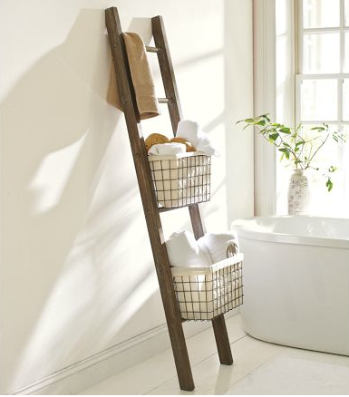 i love the idea of using a ladder for bathroom storage.  [via: pottery barn]