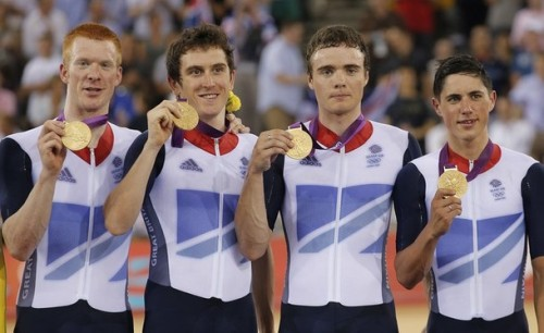 Britain's Edward Clancy, left, Steven Burke, second from left, Peter Kennaugh, second from right, and Geraint Thomas, right, show off their gold Medals after the track cycling men's team pursuit event during the 2012 Summer Olympics in London, Friday, Aug. 3, 2012. Britain broke its own world record to win its second straight Olympic team pursuit gold medal on Friday. (via Photo from AP Photo) Yahoo caption incorrect! Left to Right: Ed Clancy, Geraint Thomas, Steven Burke and Peter Kennaugh.
