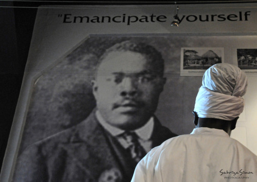 Photo Title: ~Emancipate YourSelf… ~ {Image taken of a Rastafarian of the Bobo Shanti Mansion/Order reading words from the Honourable Marcus Garvey at the Marcus Mosiah Garvey Multimedia Museum, during a celebration held on his Earthstrong in 2011 at Liberty Hall, Kingston, Jamaica.}