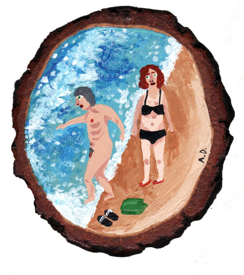 2 retirees at the beach on a wood slice