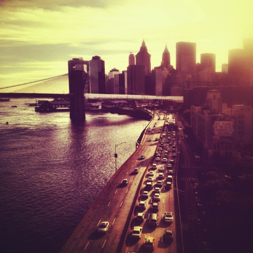"Sunset over the Brooklyn Bridge and the New York City skyline.  I love it when the sun touches the tops of the buildings in New York City on its evening descent. Its light spreads through every part of the city casting the most beautiful glow.  —-  This photo was taken with my phone. I am @newyorklens on Instagram (view my feed here).  Check out my other Instagram posts made to this blog here. You can check out all of my Instagram photos on Flickr here. Additionally, you can view my phone photography for sale here.  —-  View this photo larger and on black on my Google Plus page   —-  Buy ""Sunset over New York City"" Prints here, My mobile photography for sale here, My regular photography for sale here, email me, or ask for help."