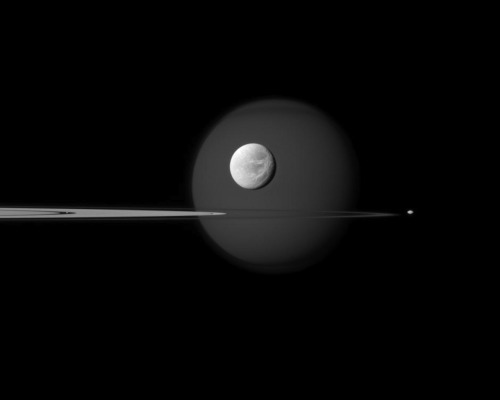 jtotheizzoe:  Seriously, Cassini … you need to stop taking such amazing pictures and let some of the other satellites have some fun. The rings of Saturn are framed by the moons Titan (rear) and the smaller Dione (front).  (via NASA/JPL and Space.com)