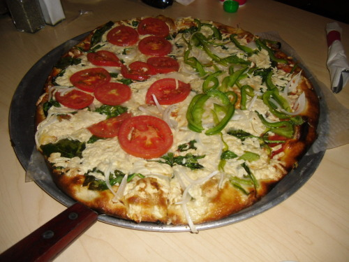 i could take one of these to the head for dolo right now. vegan pizza from Village Pizza ( Cabbagetown). Tomatoes, onions and bell pepper.