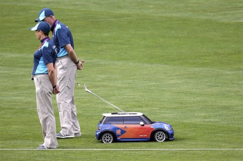 Tiny Mini Coopers are being used to retrieve hammers at the Olympics.