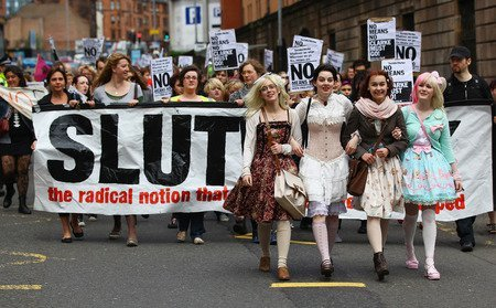 lolisdoingunlolithings:  That banner reads, 'SLUTWALK: the radical notion that nobody deserves to be raped'.