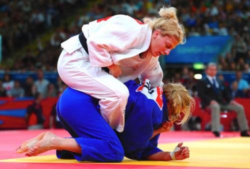 inothernews:  I know this was Thursday, but still: Kayla Harrison wins gold — the first-ever gold medal for the U.S. in this event — in the women's half-heavyweight judo final.  (Photo via Bleacher Report)