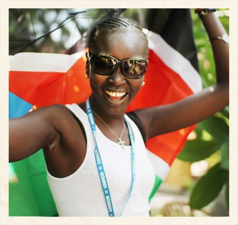 This is me, dancing in front of South Sudan's flag on the one-year anniversary of independence in Juba, South Sudan.  Photo: K.Mahoney/UNHCR