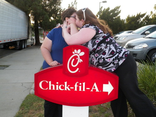 Me and my girlfriend in Northridge, CA (in front of this sign because some guys holding big american flags and 6 ft tall crosses were kinda guarding the front of the restaurant)