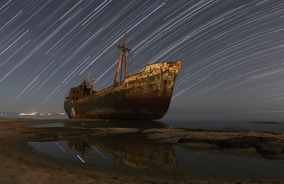 n-a-s-a:  Star Trails and the Captain's Ghost  Credit & Copyright: Chris Kotsiopoulos