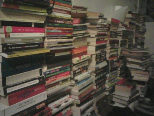 a snippet of my library. cant wait til me and rachel get our new 1br and all of  our books can be consolidated  dated is the key syllable(s)  okay, i see the illuminatus trilogy, fiction 50(for a class), gravity's rainbow, the tinkers, ulysses, major works by wittgenstein, LUNGFULL!, eugene onegin, herman hesse, charles dickens, dune, st augestine, dubliners, on the social contract, body language books, don delillo x3, cesar aira x?, paris review editions, thomas bernhard, murakami, bonhoffer, norman mailer, cormac mccarthy, david foster wallace, proust, walden, tao lin (even though i hate him), … i'm too drunk for this shit.
