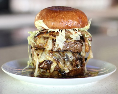 "thedailywhat:  Cheeseburger of the Day: Chef Jason Quinn of The Playground in Orange County has concocted a meaty ""Foie U"" in response to California's recent ban on foie gras. The Shut the Duck Up burger is a doubled-up version of the restaurant's popular Playground burger — Wagyu chuck & dry-age ribeye torchon patty, Tomme de Savoie and maple-bourbon onions — but topped with the fatty liver delicacy. Chef Quinn is taking advantage of some loopholes in the new law — he's not actually selling it — which make foie gras still accessible, and plans to have an eating challenge to celebrate his decadent burger. [foodbeast]"