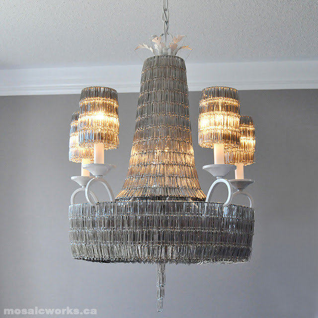 Paper Clip Chandelier | Mosaic Works Yep, that's right - paperclips!This is truly one of the coolest DIYs I've ever seen. It took over 14,700 paperclips to make this. That is true commitment to a project - I've given up over a hour on some projects! There is even a quick guide on how to create your own, though you would of course have to modify for your chandelier. If you try this - good luck! And make sure you share the pics!  via:  scissorsandthread