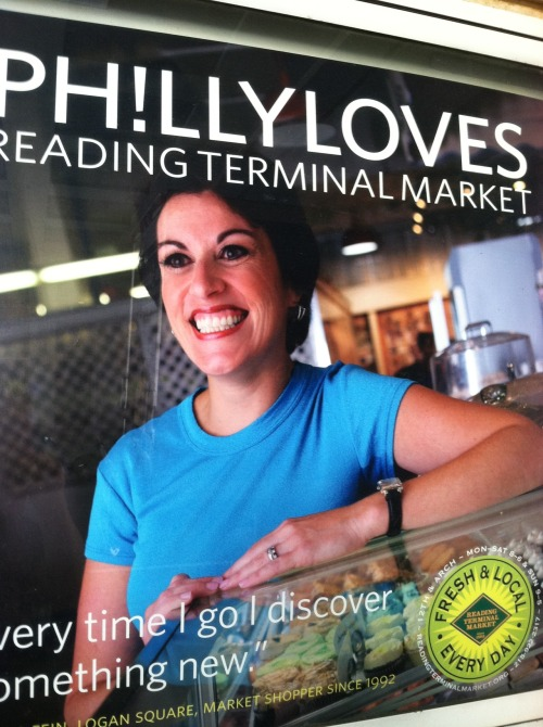 Philly does love Reading Terminal Market. This is true. Tourists love it. Philly loves it. It's one of the few places that most people can find a way to enjoy. That said, LOLadelphia reader Anna brought up a good point when she emailed us this advertisement in that this particular picture is borderline creepy.  Every time this woman goes to Reading Terminal Market she discovers something new. I believe that. Most recently I discovered that the sushi place at Reading Terminal is terrible, and the time before that I discovered that DiNic's roast pork is a massive disappointment when compared to John's Roast Pork and Tony Luke's. However, every time I see this advertisement I'm going to be looking under my bed and in my closet to make sure I'm not being watched because this lady…kinda sorta scares me. I feel like if I look at this picture long enough my soul will be sucked out of my body. Good submission Anna, thank you.